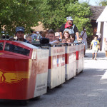 Riders on the M&M Railroad trackless train